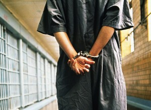 handcuffed-prisoner-in-jail-300x220.jpg