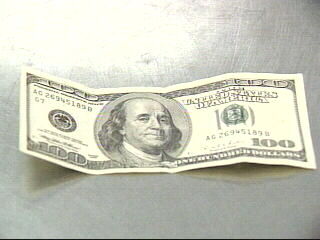 VIDEO: Suspect Who Passed Counterfeit $100 Bill