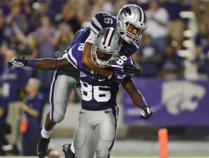 Tyler Lockett jumps on the back of Tramaine Thompson in a 2012 game.