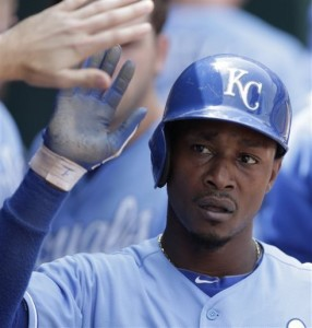 Kansas City Royals' Jarrod Dyson celebrates in the dugout after scoring on a ground out by Billy Butler during the third inning of a baseball game against the Oakland Athletics on Saturday, July 6, 2013, in Kansas City, Mo. (AP Photo/Charlie Riedel)