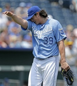 Kansas City Royals starting pitcher Luis Mendoza walks off the mound as departs the baseball game against the Oakland Athletics during the second inning, Sunday, July 7, 2013, in Kansas City, Mo. (AP Photo/Charlie Riedel)