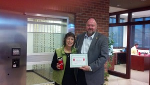 Tom Wilbur presents, BANK VI Hero of the Week, Vicki Kerbs, with her award!