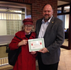 Tom Wilbur, President of BANK VI, Gives Marge Mintun her Hero of the Week Award!