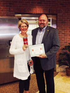 Tom Wilbur, President of BANK VI, presents Jane Gates with her Hero of the Week Award!