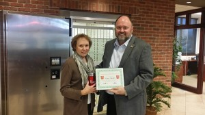 Tom Wilbur, President of BANK VI, presents Nancy Modin with her Hero of the Week Award!