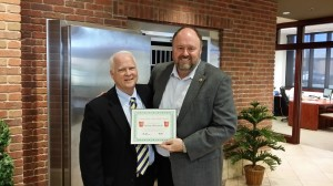 Tom Wilbur, President of BANK VI, presents Richard Blackwell with his Hero of the Week Award!