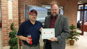 Tom Wilbur, President of BANK VI, presents Joe Komlofske with his Hero of the Week Award!