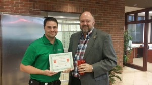 Tom Wilbur presents Bryan Herwig with his BANK VI Hero of the Week award!