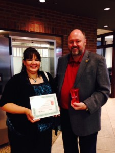 Tom Wilbur, President of BANK VI, presents Maribel Panuco with her Hero of the Week award!