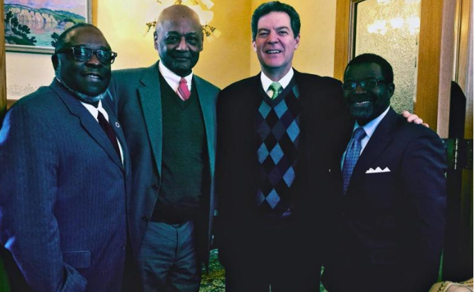 Photo by Kansas Department for Children and Families Gov. Sam Brownback, second from right, recently joined Center for Neighborhood Enterprise officials, from left, Charles Perry, Robert Woodson Sr. and Terence Mathis at the state's announcement of a new initiative to address poverty-related community issues.