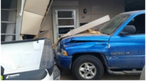 The pickup hit the house in the 100 block of West 20th on Friday. (courtesy photo by Hays Fire Department)