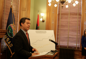 "Photo by Andy Marso Gov. Sam Brownback says he's ""not too excited"" about a proposed tobacco tax increase, but says it would have some positive health effects."