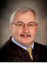 District Magistrate Judge Guy R. Steier