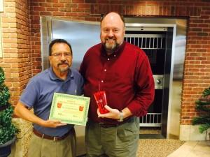 Tom Wilbur, President of BANK VI, presents Dr. J. Edgar Rosales with his Hero of the Week Award!