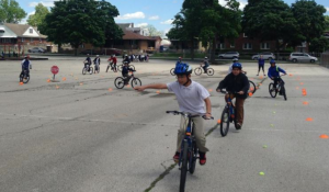 Students at Garfield Elementary School learn bicycle safety skills under the aegis of BikeWalkKC. DAN MARGOLIES HEARTLAND HEALTH MONITOR