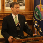 Photo by Andy Marso Gov. Sam Brownback said during a news conference Friday that rural hospitals should aim for innovation rather than Medicaid expansion to help their financial situations.