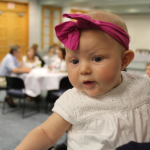 Photo by Dave Ranney Lucille Peschel, 4 months, was the youngest participant in a Kansas Action for Children-sponsored forum. Monday's forum focused on upcoming reforms in the federal government's support for child care assistance and early childhood development programs. She was accompanied by her mother, Patty Peschel, who runs the Kansas Child Care Training Opportunities program in Manhattan.