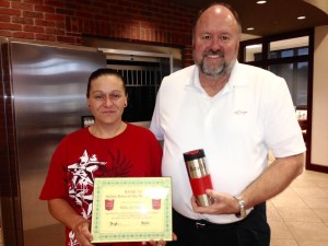 Tom Wilbur, President of BANK VI, presents Billie Jo Glavin with her Hero of the Week Award!