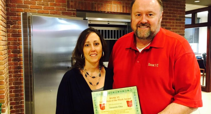Tom Wilbur, President of BANK VI, presents Amanda Otto with her Hero of the Week Award!