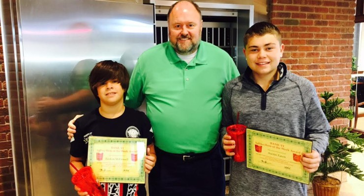 Tom Wilbur, President of BANK VI, presents Austin Eaton and Tristian McDowell with their Hero of the Week Award!
