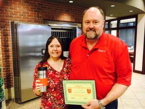 Tom Wilbur, President of BANK VI, presents Kristina Litchman with her Hero of the Week Award!