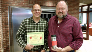 Tom Wilbur, President of BANK VI, presents Jeff Shaw with his Hero of the Week Award!