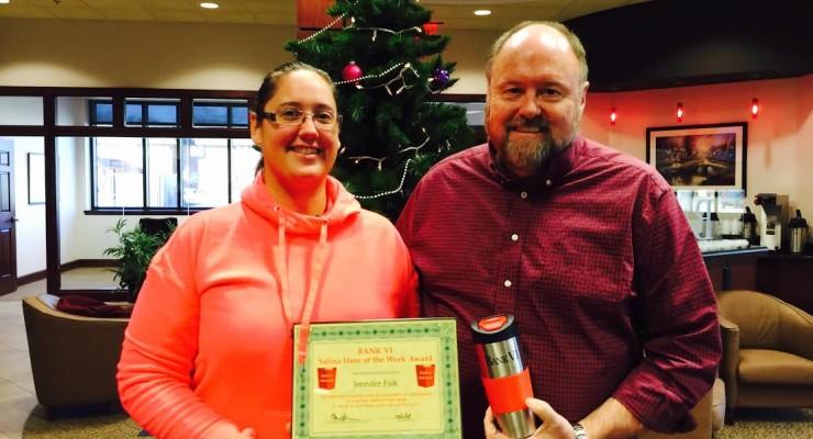 Tom Wilbur, President of BANK VI, presents Jennifer Fisk with her Hero of the Week Award!