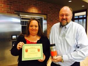 Tom Wilbur, President of BANK VI, presents Edith Kistler with her Hero of the Week Award!