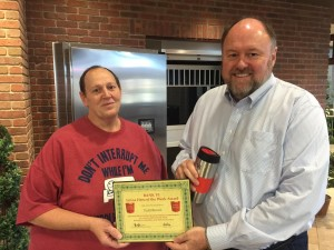Tom Wilbur, President of BANK VI, presents Todd Brown with his Hero of the Week Award!