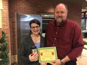 BANK VI President Tom Wilbur presents Amy Kay Pavlovich with her Hero of the Week award.