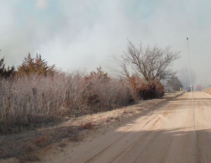 Crews work overnight to monitor scene of Kansas grass fire
