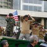 Iranians mock U.S. soldiers during parade celebrating 1979 revolution