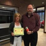 Tom Wilbur, President of BANK VI, presents Tammie McArthur with her Hero of the Week Award!