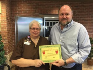 Tom Wilbur, President of BANK VI, presents Polly Howell with her Hero of the Week Award!