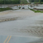 Heavy Kansas rains wash out railroad track, cause sewer overflow