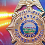 Kan. woman hospitalized after vehicle rolls passing 2 semis