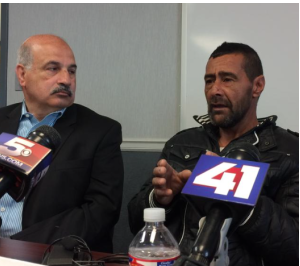 Syrian refugee Ahmad al-Abboud (right) tells his story through interpreter Fariz Turkmani at a press conference in Kansas City. photo by ALEX SMITH / KCUR