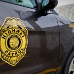 Dickinson Co. woman hospitalized after crash with semi