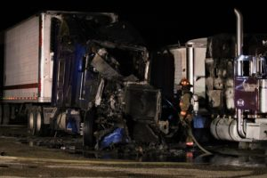 Sleeping semi driver escapes fire safely
