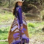 Brooke Wallace, the 2016 Miss Rodeo Kansas State Rodeo Queen, has a specially designed pair of chaps representing K-State and the Abilene rodeo. Photo by Amber Thompson.