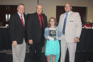 Taylor Hinderliter, a student at Smoky Valley Middle School in Lindsborg, was the winner of the 2016 DARE Essay Contest. Pictured with Hinderliter are (from left to right) Jerry Tenbrink, Statewide DARE Coordinator; Officer Doug Anderson, McPherson County Sheriff's Office; Undersheriff Derek Ploutz, Haskell County Sheriff's Office and President of Kansas Juvenile Officers Association.