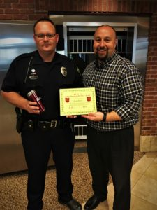Officer Micah Bunce receives his BANK VI Hero of the Week Award