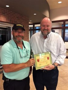 Brad Anderson is presented with the BANK VI Hero of the Week Award