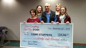 Heimer Family makes check presentation to Crimestoppers