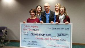 Heimer Family makes check presentation to Crimestoppers
