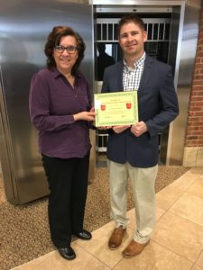 Dr. Brian Harvey receives his BANK VI Hero of the Week Award
