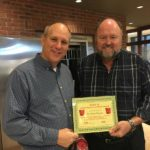 Tom Wilbur, President of Bank VI presents Pastor Barry Dundas with Hero of the Week Award.