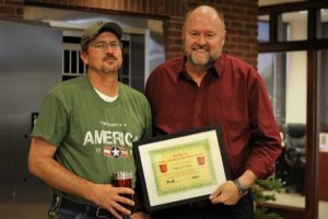 Robert Eaton is presented with the BANK VI Hero of the Week Award