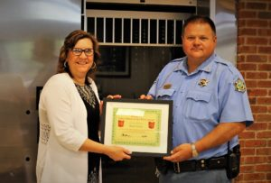 Sheriff Roger Soldan is presented with the BANK VI Hero of the Week Award