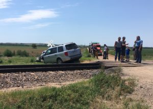 Two escape serious injuries when train hits SUV